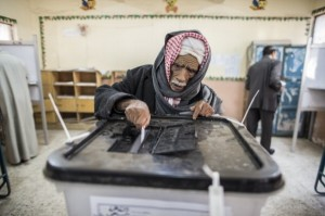 An Egyptian man casts his vote during a referendum on the new Egyptian constitution. Photograph: Daniel Berehulak/Getty Images