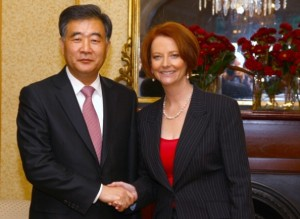 China's Wang Yang, Party Secretary of the CPC Guangdong Committee,(left), and Australian Prime Minister Julia Gillard (right). [Getty Images]