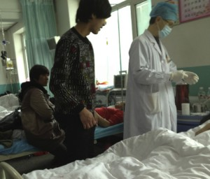 Victims of the accident at the gold mine receive medical treatment at Renmin Hospital in Huadian City, northeast China's Jilin Province. [Xinhua]