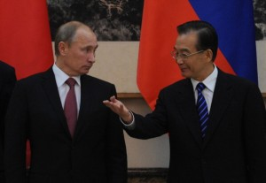 Russia Prime Minister Vladimir Putin (L) and China's Premier Wen Jiabao . [Getty Images]