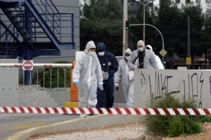 Forensic police investigate the scene after an unknown attacker fired a rifle at the offices of the Ruling Party in Athens, Greece. [Getty Images]