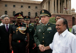 Chinese Defense Minister Liang Guanglie (c), shakes hands with Indian Defense Minister A.K. Antony. [AP]