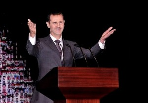 President Bashar Assad speaks at the Opera House in central Damascus. [AP]