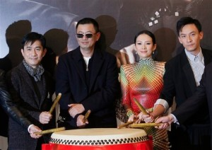 "From left, Hong Kong actor Tony Leung, Hong Kong director Wong Kar-wai, Chinese actress Zhang Ziyi and Taiwanese actor Chang Chen pose for photographs during the premiere of their latest movie ""The Grandmasters"". [AP]"