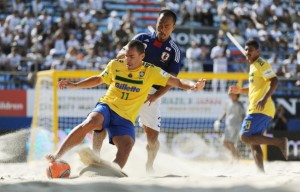 A member of the Brazil beach soccer team in action. [Getty Images]