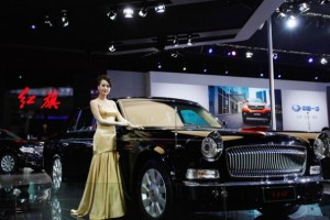 A model stands beside a car during the 2012 Beijing International Automotive Exhibition . [Getty Images]