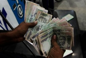 Increased demand for the greenback has pushed its value higher against the rupee [AP]