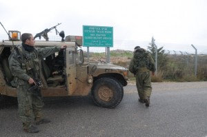 Israeli soldiers guard on the Israeli side of Syria-Lebanon border. [Xinhua]