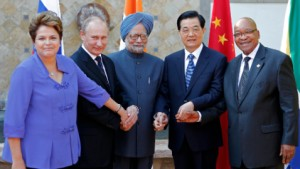 President Putin (second, left) with fellow BRICS leaders. [AP]