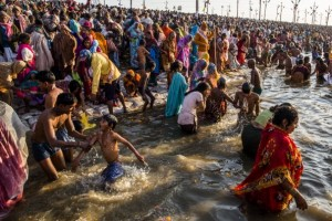 Hindu devotees bathe on the banks of Sangam. [Getty Images]