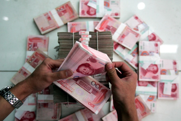 The yuan's 2 per cent rise or fall flexibility allowed by the central bank has made it a strong trading currency in Europe and Australia [Getty Images]