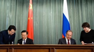 Chinese Foreign Minister Yang Jiechi (2nd L) and his Russian counterpart Sergei Lavrov (2nd R) sign the document on a bilateral negotiation plan of foreign ministries in 2013, in Moscow. [Xinhua]