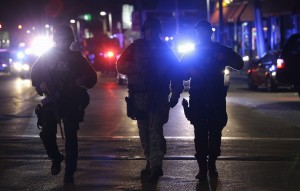 Police canvassing the suburb of Watertown in Boston [AP]