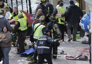 Emergency crews arrive at the scene of the blasts in Boston [AP]