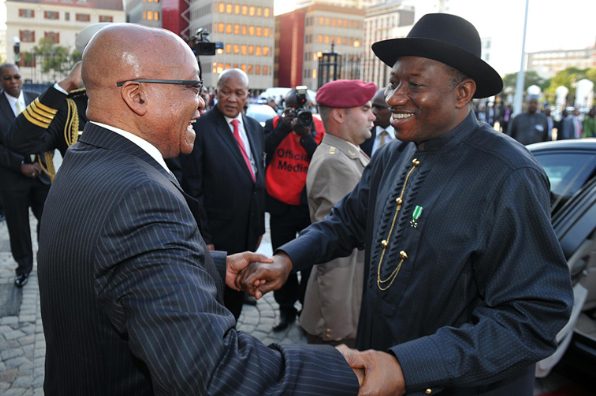 Nigerian President Jonathan Goodluck greets South Africa's Jacob Zuma, left, during his visit to Nigeria last year [GCIS]