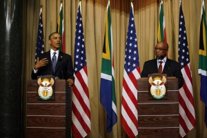 Obama, left, said his tour of Africa draws inspiration from Mandela's achievements [AP]