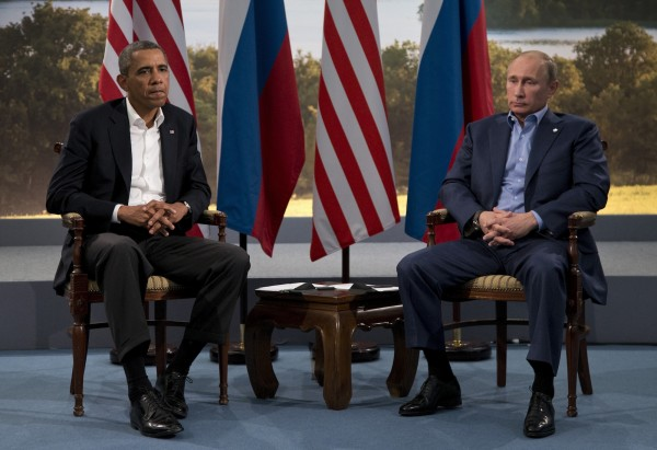 File photo of Barack Obama (left) and, Vladimir Putin [AP]