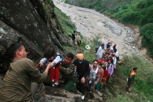 27,000 pilgrims were stranded in the remote mountainous regions of northern India. (AP Images)