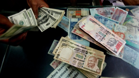 On Monday, the rupee also hit a one-month low and weakened to 60.23 per dollar, its lowest level since May 6 [AP Images]