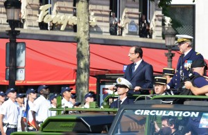 Hollande attended a Bastille Day military parade [Xinhua]