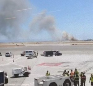 Emergency crews race to the site of the Asiana Airline jet [AP]