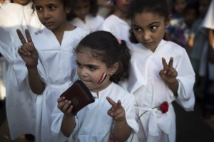 Egyptian society, NGOs and international organizations have raised concerns about pictures such as the one above showing children in martyrdom robes [AP]