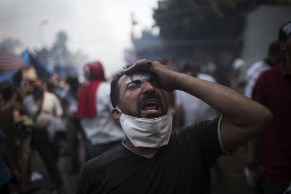 A pro-Morsi supporter in Rabaa Al Adawiya reacts to the violence which resulted when government security forces tried to forcibly disperse the protest camp [AP]