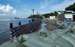 Protective sandbags are placed on a bank of the flooded Amur River in Khabarovsk [AP]