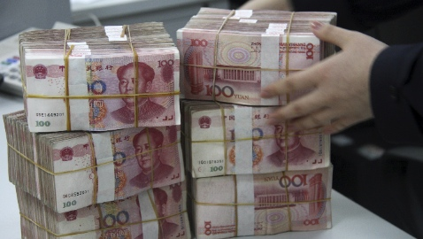 China is promoting the use of its currency as an alternative to the dollar in global trade and finance [Xinhua]