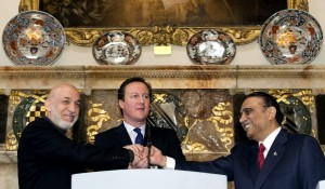 Britain's Prime Minister David Cameron (C) shakes hands with Afghan President Hamid Karzai (L) and Pakistani President Asif Ali Zardari [Getty Images]