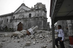Dozens of buildings including historic churches were damaged in the quake Tuesday [AP]