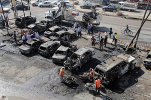 Destroyed cars in the wake of a bombing near a marketplace in Baghdad [AP]