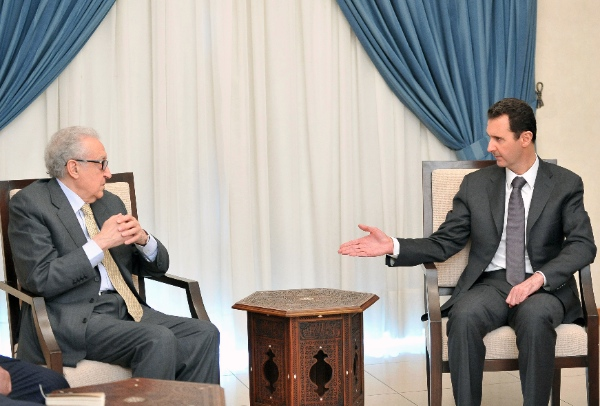 Syrian President Bashar Assad, right, speaks with U.N.-Arab League envoy for Syria, Lakhdar Brahimi during one of his diplomatic missions to Damascus, Syria  [AP]