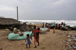 The Indian weather body said the storm surges would scale heights of 3-3.5 meters. Storm surges are the wall of water pushed up by the winds and could pose the major threat to lives [AP Images]