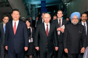 Developments on the BRICS Bank work, largely credited as the Indian Prime Minister's initiative, and greater BRICS cooperation will be discussed during Singh's visit to the two countries [AP]