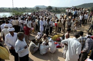 Local media reports are saying most victims who died on the bridge, crushed by other devotees were children [AP Images]