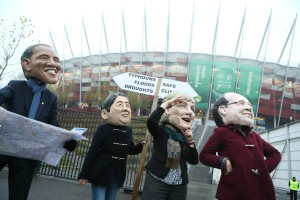 Protesters wearing masks of the leaders of the wealthiest countries have criticised the lack of progress at the UNFCCC [Xinhua]