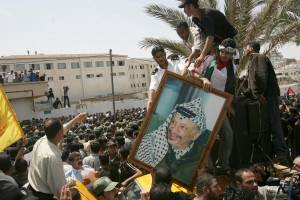 Arafat, seen here in a portrait carried by his supporter on the second anniversary of his death, has been an iconic leader for some Arabs [Getty Images]