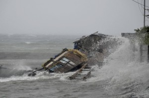 Wind gusts reached up to 275 km/h as Typhoon Haiyan battered central and eastern Philippines [AP]