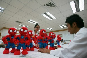 Chinese workers check Spiderman dolls assembled for export in Guangdong province in China [Getty Images]