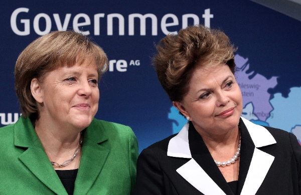 File photo of German Chancellor Angela Merkel (left) and Rousseff, the world's most powerful women according to Forbes [AP]