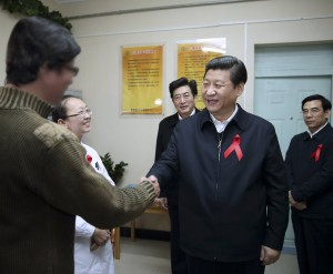 Xi visits an HIV-positive patient as part of World Aids Day events in 2012 [Xinhua]