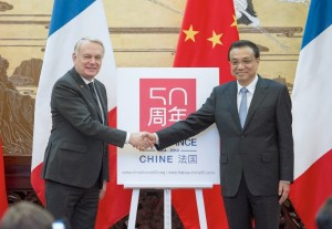 Ayrault is accompanied by French Ministers of industry, energy, tourism and agriculture [Xinhua]