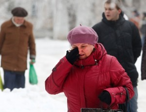 A Volgograd resident walks crying in Volgograd, Russia early Monday, Dec. 30, 2013 [AP]