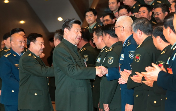Chinese President Xi Jinping (C), and chairman of the Central Military Commission, shakes hands with delegates attending the People's Liberation Army (PLA) logistics work conference, in Beijing, capital of China, Nov. 18, 2013 [Xinhua]