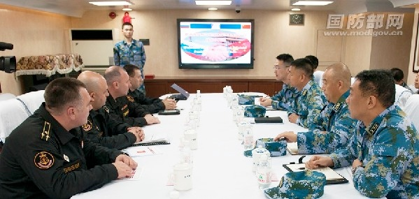 Chinese and Russian officials hold discussion aboard the Yancheng [Image Courtesy: Defense Ministry of China]