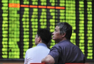 Investors watch the electronic board at a stock exchange hall on June 24, 2013 in Jiujiang, China [Getty Images]