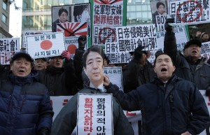 South Korean protesters shout slogans during a anti-Japan rally in front of the Japanese embassy on December 27, 2013 in Seoul, South Korea [Getty Images]