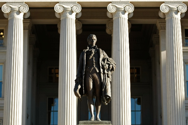 A statue of the first Secretary of the Treasury Alexander Hamilton stands in front of the U.S. Treasury Department building in Washington, DC [Getty Images]