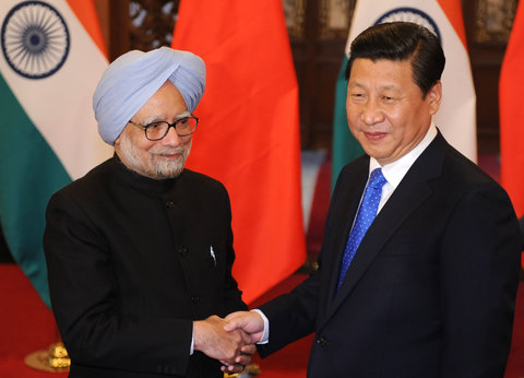 Manmohan Singh, left, prime minister of India, with Chinese President Xi Jinping [Getty Images]